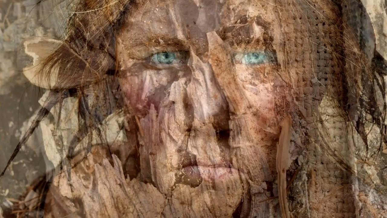 Dunkle Haut Blaue Augen